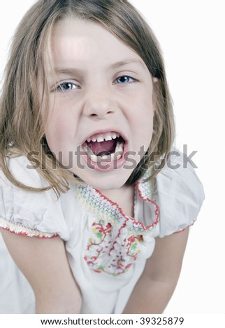 a cute little girl growls at the camera
