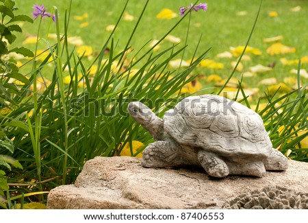 A Cute Stone Turtle Made of Stone in a Lovely Yard Setting