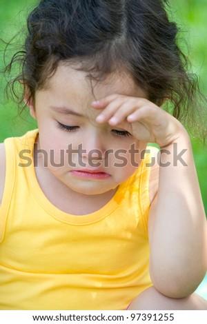 a cute 4 year old girl cries, closeup