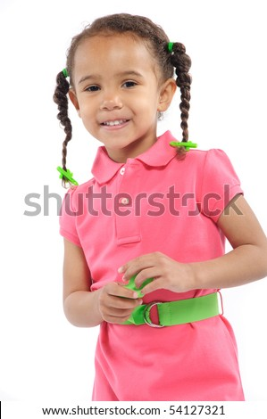 A cute 4 year old in pigtails wearing a pink dress
