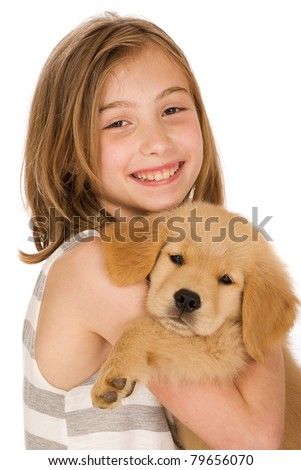 a cute young girl holding a Golden Retriever Puppy