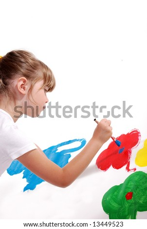 A cute young girl painting a picture
