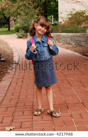 A cute young girl ready for her first day of school