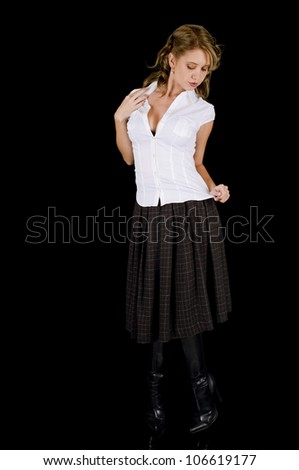 A cute young woman posing seductively in her white shirt and plaid skirt.