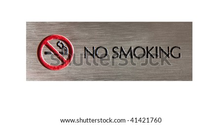 A cutout no smoking side lit strongly from the side to show the texture of the engraving and the metal.