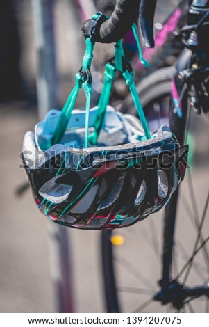 A cycle helmet, waiting for the triathlon participant to change for the cycling part of the race.