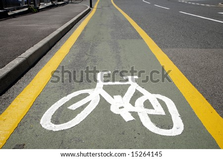 A cycle lane and white sign.