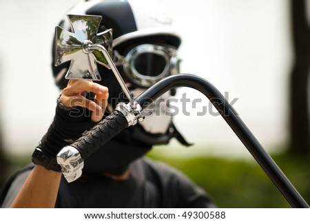 a cyclist biker with a skull-mask