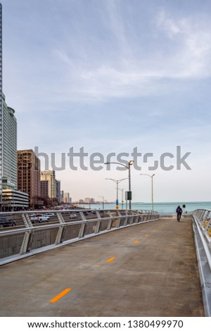 A cyclist is riding on the Lakefront Flyover along Lake Shore Drive. Main streets in Chicago, streets in Illinois.