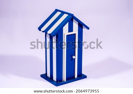 A 3D rendering illustration of a tiny white and blue house isolated on a white backgrou