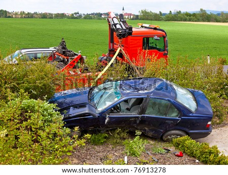 A damaged car after a traffic accident. Vehicle is turned over.