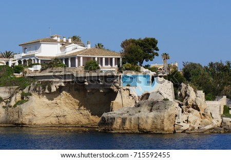 A damaged house due to coastal erosion and climate change.