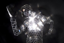 a dancer performs wearing an incredible disco mirror suit that sparkles in the light