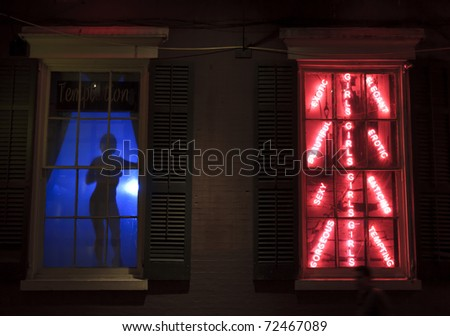 A dancer silhouetted in a window on Bourbon Street in the French Quarter of New Orleans