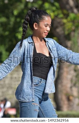 A Dancing Pretty Minority Female #1492362956