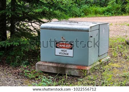 a danger high voltage sign on...
