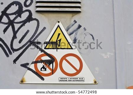 a danger sign and urban graffiti