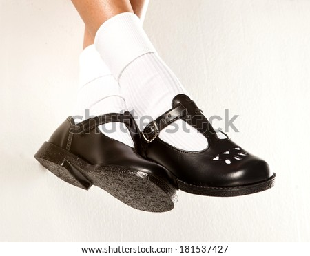 a dangling set of legs with white socks and
