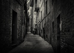 A dark and moody back alley taken in the historic town of  Recanati, Macerata, Marche, Italy