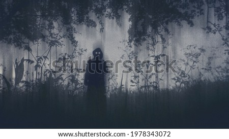 A dark scary concept. Looking up at a mysterious supernatural figure with glowing eyes looking at the camera. With a grunge, textured edit Stock photo ©