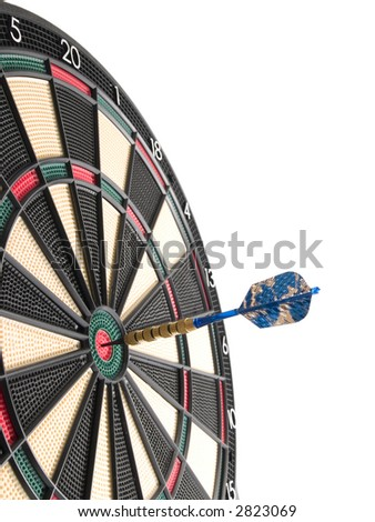 a dartboard with a dart hitting the bullseye in the center of the board. - stock photo