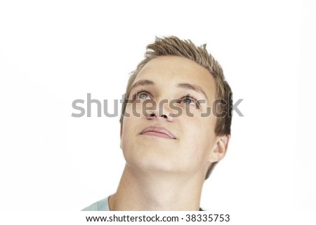 A daydreaming young man on a white background