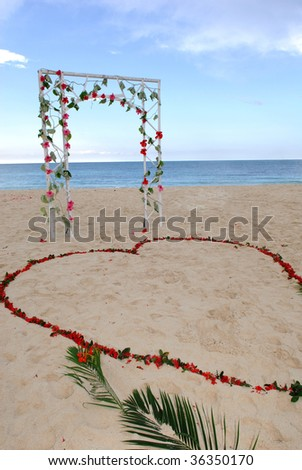 stock photo A decorated wedding arch with a heart made of flowers in the