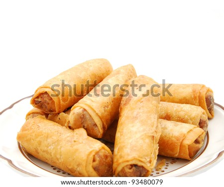 A decorating egg rolls food