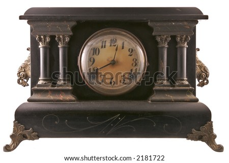 A decorative antique mantle clock isolated on a white background.