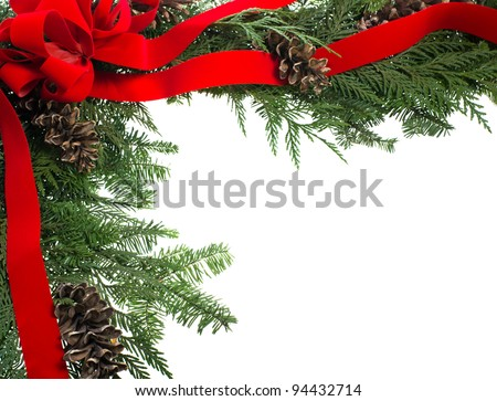 A decorative border with red ribbon bow and pine cones isolated on white
