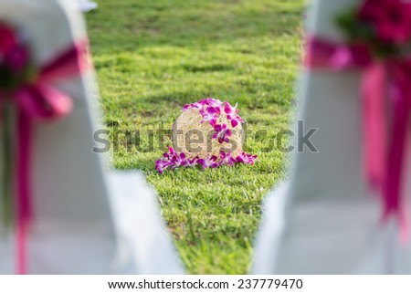 A decorative flower ball on the ground