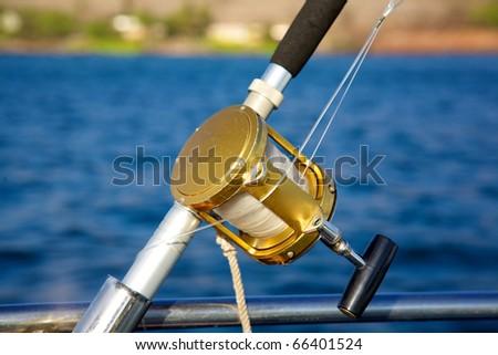 A deep sea fishing rod and reel stock photo 66401524 for Deep sea fishing rod and reel