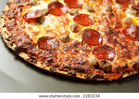 A delicious and tasty pepperoni and beef pizza