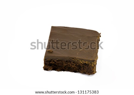 A delicious brownie covered in fudge isolated against white with plenty of room for copy