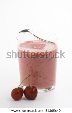 a delicious cherry milkshake isolated over white