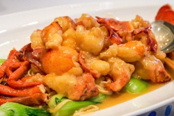 A delicious Chinese Cantonese dish, baked lobster cubes with cheese