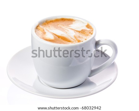 A delicious cup of freshly made cappuccino or macchiato on a white saucer. Isolated over white with clipping path.