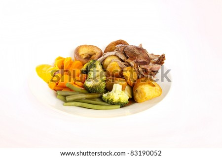 A delicious English roast dinner with all the trimmings, from lamb, gravy and Yorkshire puddings. English roast dinner.