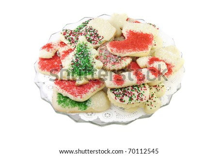 A delicious plate of decorated Christmas cookies, isolated on white background