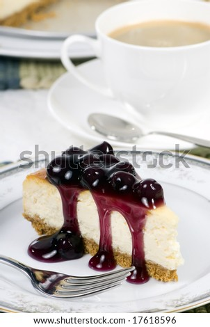 A delicious slice of cheesecake with fruit topping.