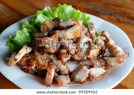a delicious sliced grilled pork  served with vegetables