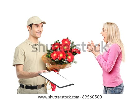 A delivery boy holding a bunch of flowers and surprised woman isolated on white background