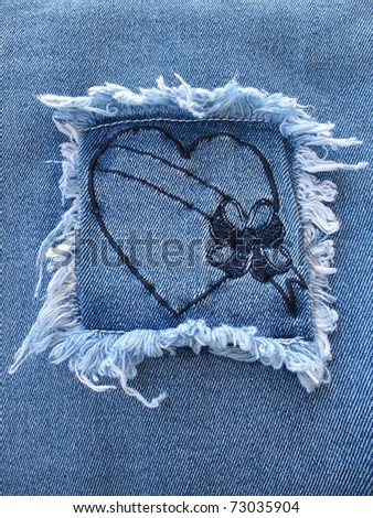 A denim square patch containing a heart with a blank banner across it.