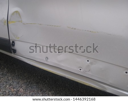 A dented sill and sliding door in an accident damaged  white van #1446392168