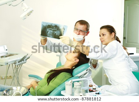 A dentist holding an x-ray