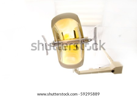 A dentist light or lamp against the ceiling of the room