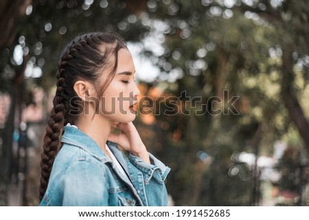A depressed teenage asian girl after being heartbroken, bullied or ostracized. Stock photo ©