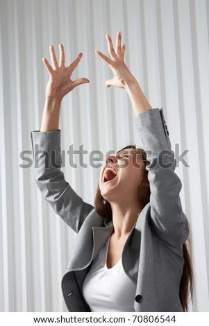 A depressed woman raising her hands and screaming