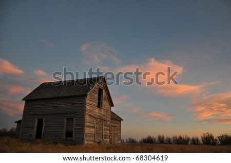 "A derelict, abandoned farmhouse in central Saskatchewan. ""Still Standing Proud"". The family farms in the prairies just seem to be fading away, but this old farmhouse stands proud against setting sun."