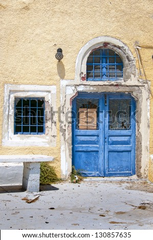 A derelict building lies abandoned in poverty stricken Greece.